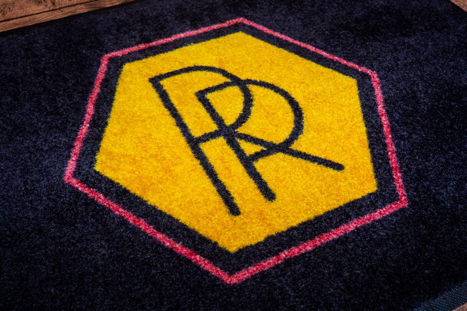 Reena Ravi Design Carpeted Logo Rug Studio 3 Signs